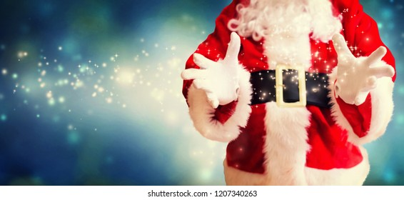 Santa with holding gesture in snowy night