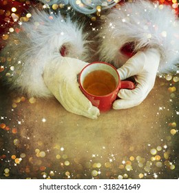Santa holding mug of tea