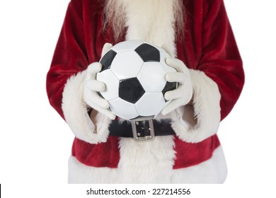 Santa holds a classic football on white background