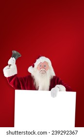 Santa holds a sign and rings his bell against red background