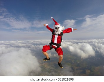 Santa jumping with a parachute