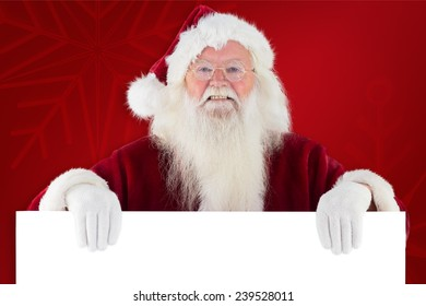 Santa looks over a sign against red background