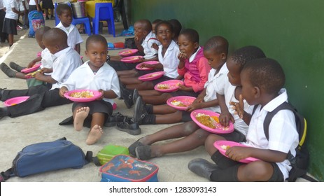 Santa Lucia, KwaZulu-Natal, South Africa - February 2.2016 Needy schoolchildren in a village near Santa Lucia eating lunch as part of a school catering scheme in South Africa.