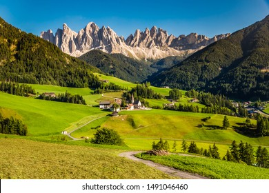 Santa Maddalena Church And Geisler (Odle) Dolomites Mountain Peaks  - Val Di Funes, South Tyrol, Italy