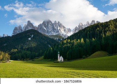 Santa Maddalena church in the Val di Funes valley in front of the Dolomites Alps mountains
