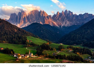 Santa Maddalena village with magical Dolomites mountains in background, Val di Funes valley, Trentino Alto Adige region, Italy, Europe. Sunset view of dramatic Italian Dolomites landscape.