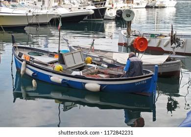 Santa Margherita Liguria, Italy - 04/12/2011: Fishing boats in the port of Santa Margherita Liguria, a coastal city in the Italian region of Liguria on the Mediterranean Sea.
