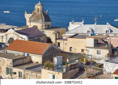 Santa Maria Assunta cathedral church in Ischia Ponte seen from above the rooftops, Ischia Island, Italy