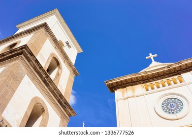 Santa Maria Assunta Church in Positano town on Amalfi Coast and Tyrrhenian Sea in Italy in summer. View of beautiful Mediterranean cathedral architecture near Sorrento. Blue sky on background