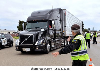 Santa Maria, California, USA-May 10, 2016: Inspectors from the California State Environmental Protection Agency-Air Resources Board pull over a big rig during a  surprise truck inspection stop.