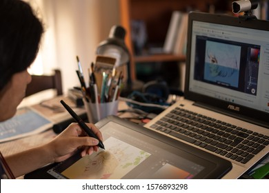Santa Maria Capua, Caserta, Italy, December 01th 2019, A young girl is learning digital drawing in a YouTube tutorial