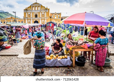 Santa Maria de Jesus, Guatemala - August 20, 2017: Colorful Sunday market in front of church in small indigenous town on slopes of Agua volcano near UNESCO World Heritage Site of Antigua