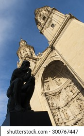 Santa Maria de la Redonda Procathedral and the silhouette of The Thinker in Logrono, La Rioja. Spain.