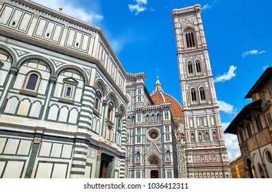 Santa Maria del Fiore Cathedral (Duomo) in Florence. Italy. High bell tower on blue sky background. Sunny day.