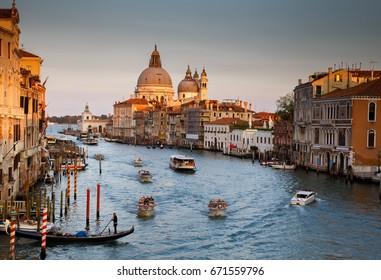 Santa Maria della Salute church and Grand Canal on sunset, Venice, Italy.