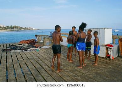 Santa Maria, Sal, Cabo Verde - Cape Verde, África - August 24, 2018. Kids playing in Santa Maria beach, Sal Island, Cape Verde africa