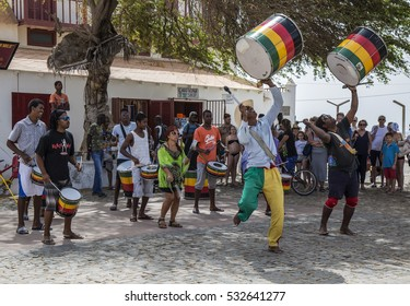 Santa Maria, Sal, CApe Verde - March 27th, 2016' Drum musicians performing and dancing in square on Santa Maria on Sal, one of the Cape Verde islands, in Spring.  Clearly enjoying themselves!