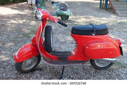 SANTA MARINELLA, LAZIO, ITALY - SEPTEMBER 28, 2014: Red vintage 50s Vespa Scooter, iconic symbol of Italy, manufactured by Piaggio, exposed with the occasion of antique modelling exhibition.
