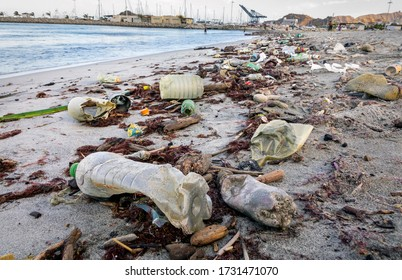 Santa Marta - Colombia, 15. January  2020: Beach pollution. Plastic bottles and other garbage on the sea beach in Santa Marta, Colombia