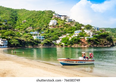 SANTA MARTA, COLOMBIA - OCTOBER 10, 2017: Beautiful outdoor view of a boat in the water in a caribean beach. Taganga, Colombia