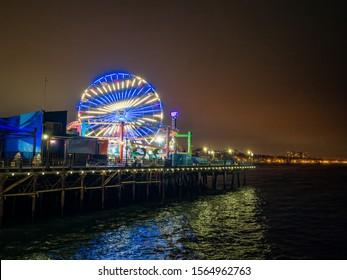 Santa Monica - Aug 2019: Pacific Park at night on Santa Monica Pier (Yacht Harbor, Sport Fishing Boating, Cafes), Los Angeles California.