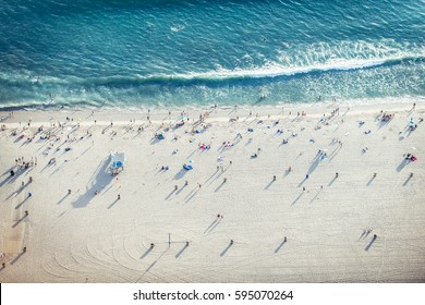 Santa Monica beach, drone view - People sunbathing on the beach and swimming in the ocean