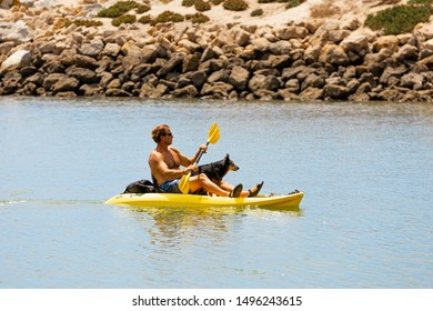 Santa Monica, CA - 8/21/2019: Unidentified man in a small boat together with his dog.