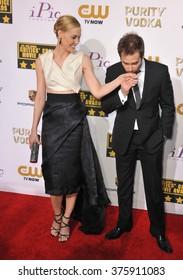 SANTA MONICA, CA - JANUARY 16, 2014: Leslie Bibb & Sam Rockwell at the 19th Annual Critics' Choice Awards at The Barker Hangar, Santa Monica Airport.