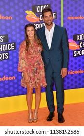 SANTA MONICA, CA. July 19, 2018: Danica Patrick & Aaron Rodgers at the Nickelodeon Kids' Choice Sports Awards 2018 at Barker Hangar