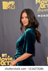 SANTA MONICA, CA - June 16, 2018: Olivia Munn at the 2018 MTV Movie & TV Awards at the Barker Hanger, Santa Monica Airport