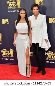 SANTA MONICA, CA - June 16, 2018: Kim Kardashian West & Kris Jenner at the 2018 MTV Movie & TV Awards at the Barker Hanger, Santa Monica Airport