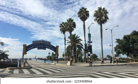 SANTA MONICA, CA, NOV 2017: multi-directional crosswalk and palm trees at entrance to the pier in Downtown Santa Monica, Los Angeles County