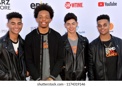SANTA MONICA, CA. September 07, 2018: 4th Ave - Jaden Gray, Camry Jackson, Mikey Jimenez & Marcus Pendelton - at the 2018 Stand Up To Cancer fundraiser at Barker Hangar, Santa Monica Airport.