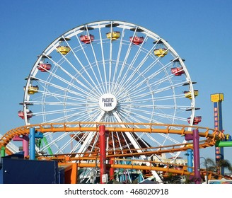 SANTA MONICA, CALIFORNIA - JUL 18: Santa Monica pier Pacific Park oceanfront amusement park's Ferris wheel is the world's first and only solar powered Ferris wheel. Santa Monica Jul 18, 2016.