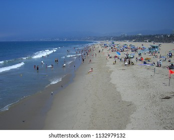 SANTA MONICA, CALIFORNIA - JULY 1: Santa Monica beach-goers on July 1, 2012 in Santa Monica, California. The city has 3.5 miles of beach locations and averages 340 days of sunshine every year.
