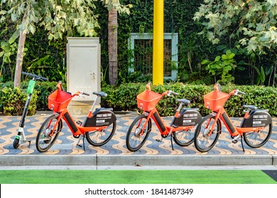 Santa Monica, California - October 09 2019: Jump dockless electric bikes and a Lime scooter parked. These vehicles are a modern transportation ride sharing system by Uber/ Lime.