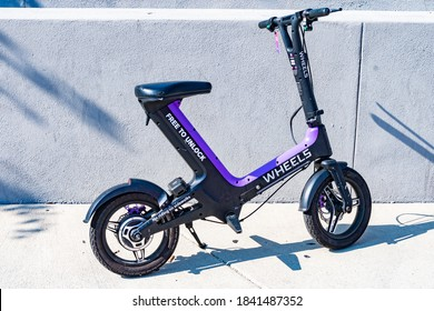 Santa Monica, California - October 09 2019: Wheels Electric Bike/ Mini-Bike, a modern design dockless battery operated micromobility rental vehicle. It is a bike and scooter alternative with no pedals