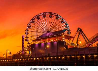 Santa Monica, California, USA - December 27, 2017 : Sunset at the Santa Monica Pier with a view of the ferris wheel in Los Angeles, California.