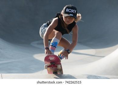 Santa Monica, California, USA - October 19, 2017 - A young girl performing tricks at Venice Beach Skate Park
