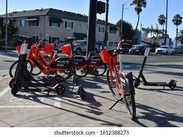 SANTA MONICA, CA/USA - October 31, 2019: Uber and Bird electric bicycles and scooters clog the sidewalks in Santa Monica California