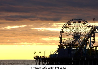 Santa Monica Ferris Wheel and Roller-coaster at Sunset