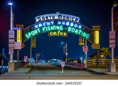 SANTA MONICA - JAN 14, 2015: Santa Monica Yacht Harbor Sport Fishing and Boating Entrance Sign in Los Angeles California at Night. Santa Monica is a beachfront city in Los Angeles California.