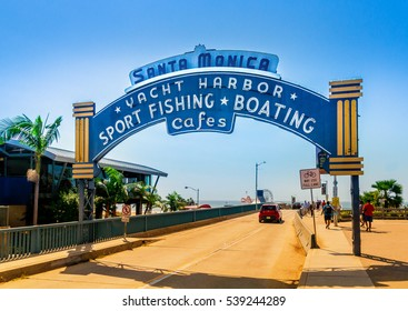 Santa Monica, Los Angeles, CA - September 24, 2015: Santa Monica Pier, Picture of the entrance with the famous arch sign. The amusement park on the pier is a world-famous tourist attraction.