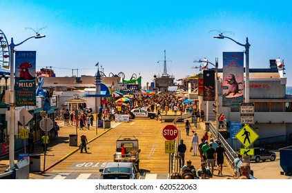 Santa Monica, Los Angeles, CA - September 24, 2015: Santa Monica Pier, Picture with people walking at the pier with the end of Route 66. The amusement park is a world famous tourist attraction.