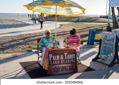 SANTA MONICA, LOS ANGELES - July 10, 2015:  A psychic on the Venice Boardwalk in the Santa Monica area of California.  According to IBISWorld, the psychic industry is a $2 billion industry.