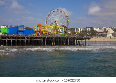 The Santa Monica Peir amusement rides lit up by the setting sun.