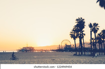 Santa Monica pier and beach at sunset, California