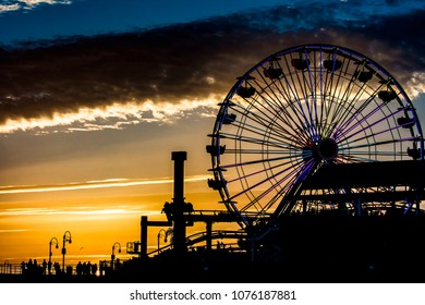 The Santa Monica Pier and the ferris wheel during a beautiful California sunset