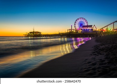 The Santa Monica Pier at sunset, in Santa Monica, California.