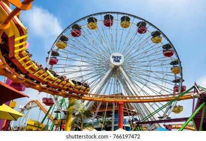Santa Monica Pier wheel and rollercoast on the amusement park, on August 12th, 2017 - Santa Monica, Los Angeles, LA, California, CA, USA
